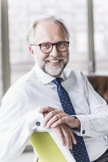 Portrait of smiling mature businessman - UUF12735