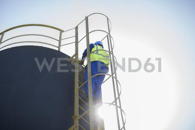 South Africa, Cape town, Construction worker climbing up ladder - ZEF15001