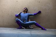 Superhero crouching against wall - FSIF01194