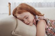 Cute girl sleeping on sofa at home - FSIF01221