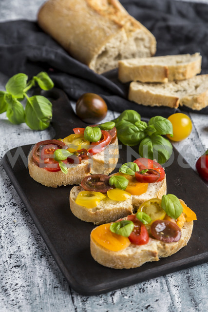 Bruschetta, ciabatta with multi-coloured tomatoes and basil - SARF03568