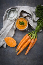 Glass of sweet potato carrot soup garnished with chives - LVF06695