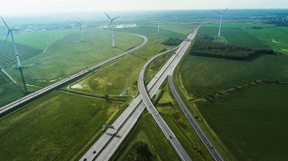 Aerial view of highways by wind turbines on field, Berlin, Brandenburg, Germany - FSIF01357