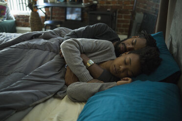 High angle view of couple sleeping on bed at home - FSIF01360