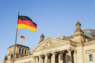 Germany, Berlin, Regierungsviertel, Reichstag building with German Flags - GWF05430