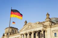 Germany, Berlin, Regierungsviertel, Reichstag building with German Flags - GWF05430