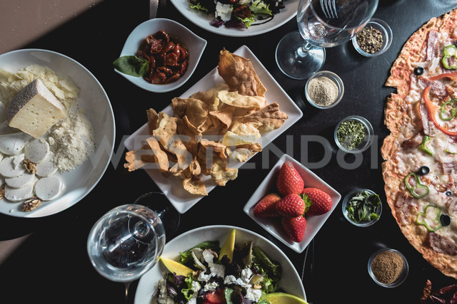 Table with italian food, salads and snacks - OCAF00120