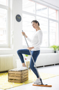 Vital woman at home wiping the floor - MOEF00799