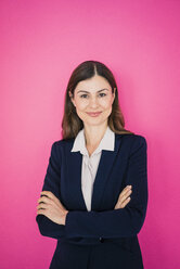 Portrait of confident businesswoman in front of pink wall - MOEF00850