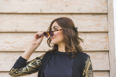 Young woman with sunglasses watching something - AFVF00062