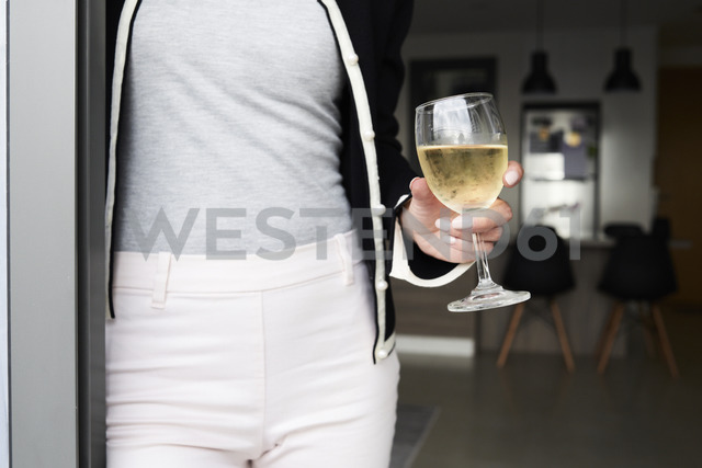 Close-up of woman having a glass of wine at home - IGGF00406