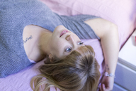 Woman lying on bed - AFVF00069