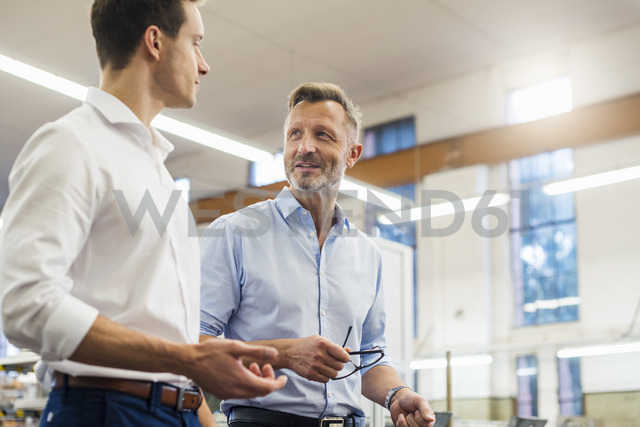 Two businessmen discussing in factory - DIGF03377