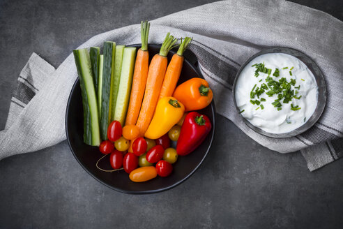Bowl of chive dip, cherry tomatoes and various vegetable sticks - LVF06717
