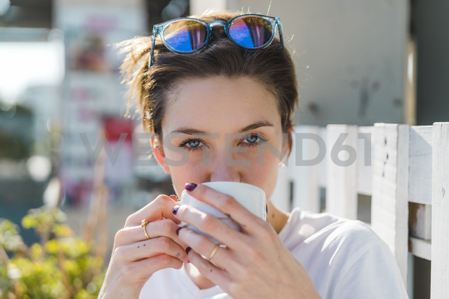 Portrait of woman drinking cup of coffee - AFVF00090