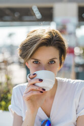 Portrait of woman drinking cup of coffee - AFVF00093