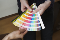 Midsection of business colleagues with color swatches in office - FSIF01366