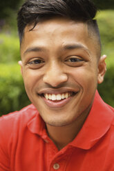 Close-up portrait of happy young man at yard - FSIF01567