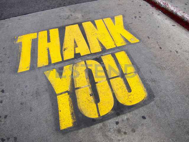 High angle view of yellow thank you text on road - FSIF01636 - fStop/Westend61