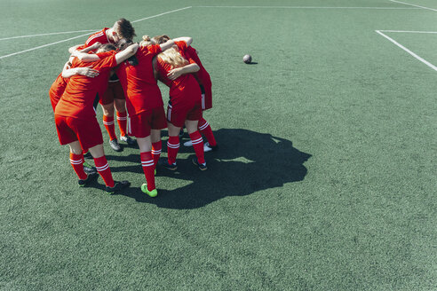 High angle view of soccer players huddling on field - FSIF01750