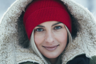 Close-up portrait of beautiful young woman wearing hood - FSIF01876