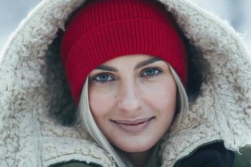 Close-up portrait of beautiful young woman wearing hood - FSIF01876