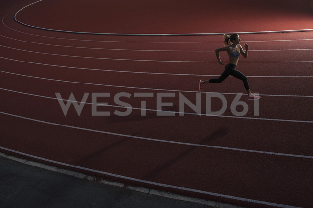 High angle view of young female athlete running on race track - FSIF01897 - fStop/Westend61