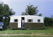 A person standing in the door of a camper - FSIF02002