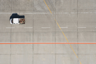 Aerial view of van driving across airport tarmac - FSIF02077