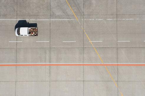 Aerial view of van driving across airport tarmac - FSIF02077