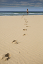 Mid distance of woman at beach against sky - FSIF02296