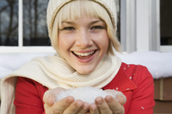Young woman with a handful of snow - FSIF02338