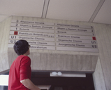 University student looking at the information signs in the foyer of a science faculty building - FSIF02356