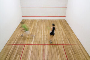 High angle view of two people playing squash - FSIF02410