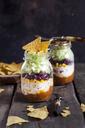 Taco salad, chili con carne, sour cream, corn, kidney beans, iceberg lettuce in a jar, nacho chips - SBDF03470