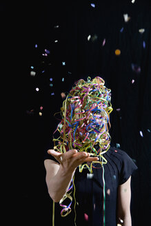 A woman covered in streamers and throwing confetti - FSIF02474