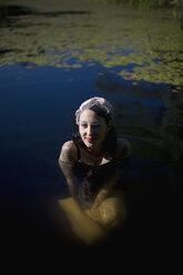 A woman bathing in a pond - FSIF02546