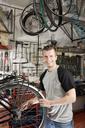 A man repairing a bike in a workshop - FSIF02609