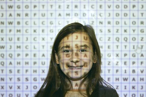Portrait of smiling schoolgirl in front of  interactive whiteboard - ZEDF01201