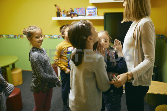 Teacher standing with students in class - ZEDF01222
