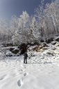 Russia, Amur Oblast, man in snow-covered nature - VPIF00307