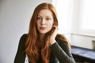 Portrait of serious redheaded woman - FMKF04873