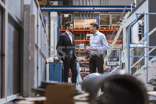 Two businessmen discussing in factory - DIGF03441