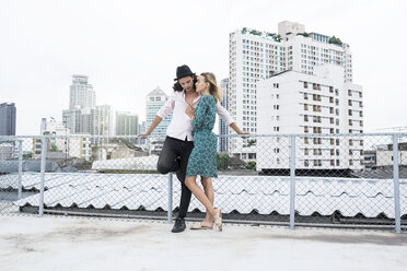 Portrait of a young affectionate couple on a rooftop - SBOF01365