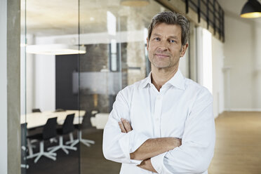 Portrait of confident businessman in modern office - PDF01464