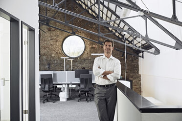Portrait of mature businessman in modern office - PDF01524