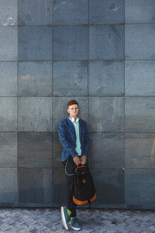 Portrait of redheaded young man outdoors with headphones - VPIF00360