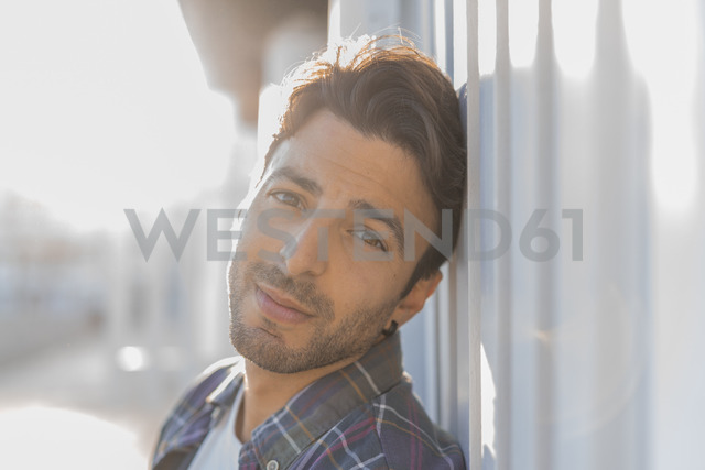 Portrait of young man on the beach at sunlight - AFVF00144