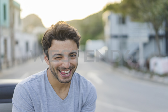 Portrait of laughing young man pulling funny faces - AFVF00153