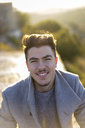 Portrait of smiling young man at sunset - AFVF00168
